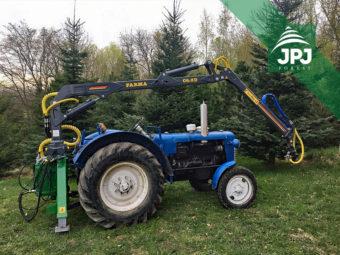 Traktor a hydraulická ruka